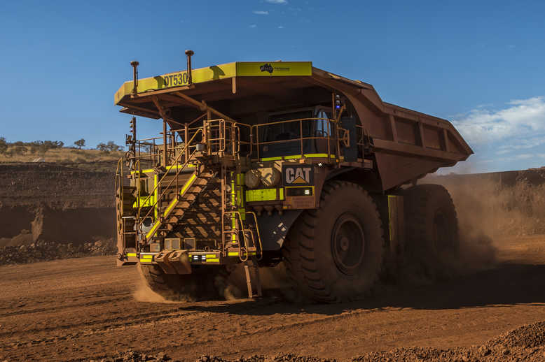 Cat 793F CMD Mining Truck leaving iron ore pit